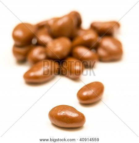 Pile Of Chocolate Raisins On White