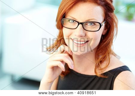Close-up image of a lovely woman wearing eyeglasses