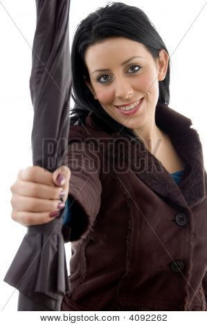 Front View Of Smiling Woman Holding Umbrella On White Background