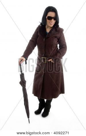 Front View Of Posing Woman With Umbrella On White Background