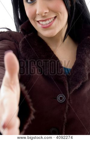 Front View Of Female Offering Handshake On White Background