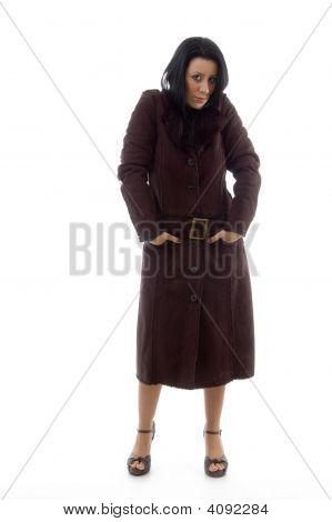Front View Of Woman Wearing Overcoat On White Background