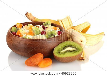 Cottage cheese in color bowl with exotic fruits, isolated on white