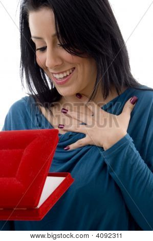 Front View Of Surprised Woman Looking In Jewellery Box