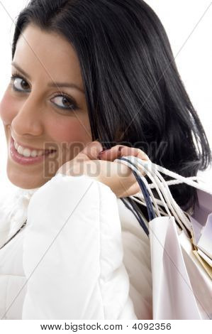Side Pose Of Smiling Woman Carrying Shopping Bags