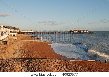 HASTINGS, ENGLAND - JANUARY 1: The shingle beach and Victorian pier on January 1, 2013 at Hastings, East Sussex. Badly damaged by fire in October 2010, the pier is scheduled for restoration in 2013.