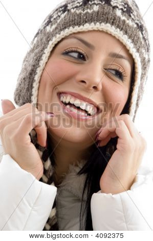 Portrait Of Cheerful Female With Woolen Cap