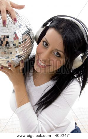 Portrait Of Smiling Female Holding Disco Mirror Ball