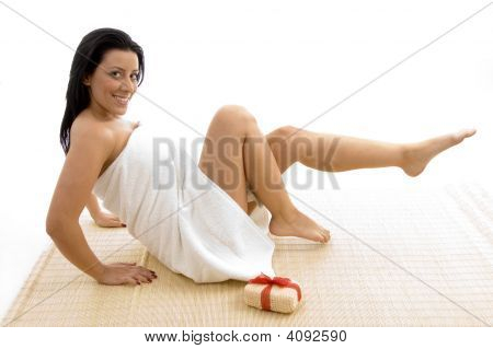 Front View Of Woman In Towel Posing With Scrubber