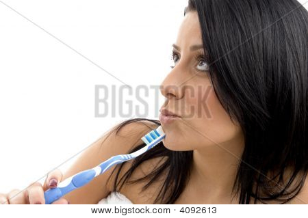Portrait Of Female Looking Upward With Toothbrush