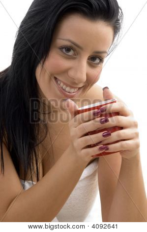 Front View Of Smiling Woman Holding Coffee Mug
