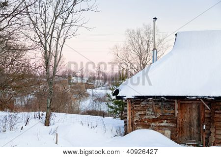 Snowcovered Wooden House In Country