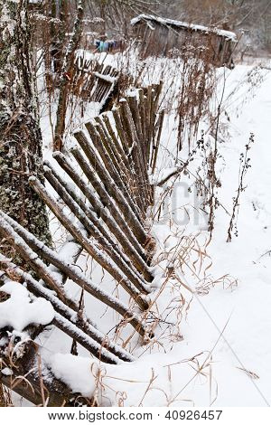Backyard Rickety Fence In Winter