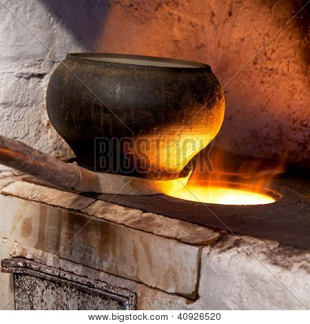 Russian Stove And Old Iron Pot