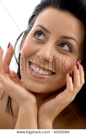 Close Up Of Smiling Woman Looking Upward