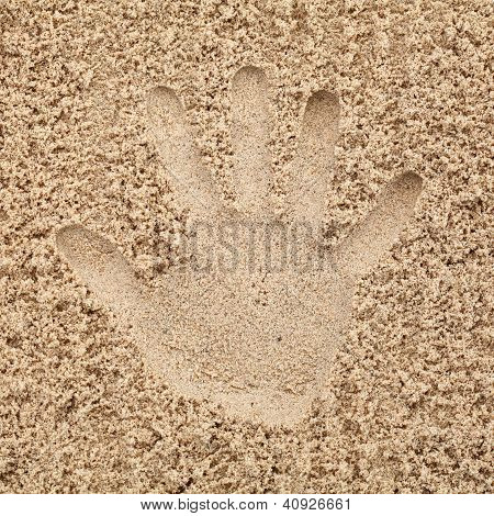 Hand In Sand On Beach