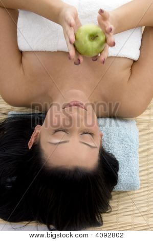 High Angle View Of Smiling Woman Holding Apple