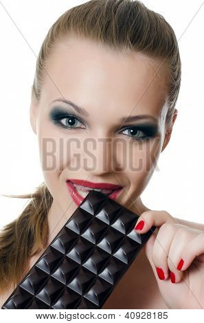 The girl with a chocolate bar isolated