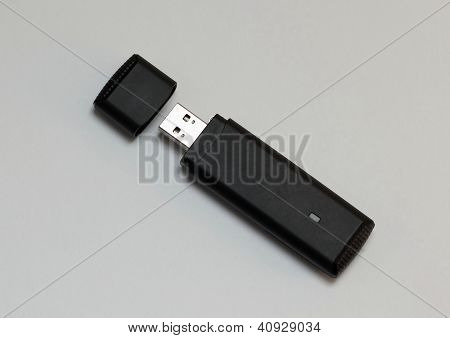 A black USB internet stick on a white backround