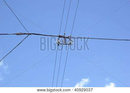 A power line in front of the blue sky