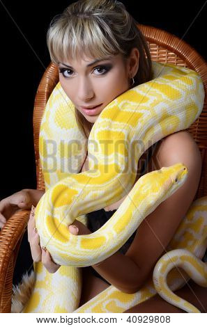 The beautiful woman with big yellow snake