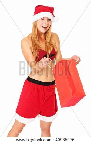 A portrait of a sexy woman in Santa's hat standing over white background with a shopping bag