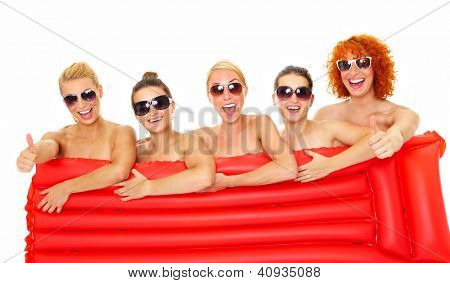Picture of five happy women covering their body with a red mattress over white background