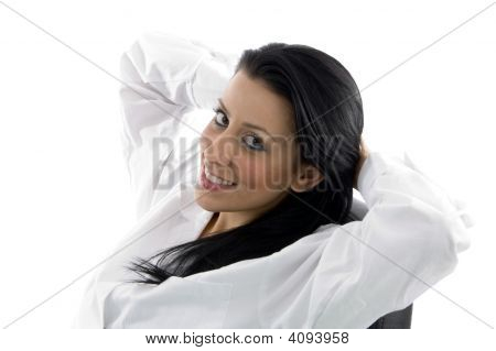 Side Pose Of Doctor Looking At Camera On White Background