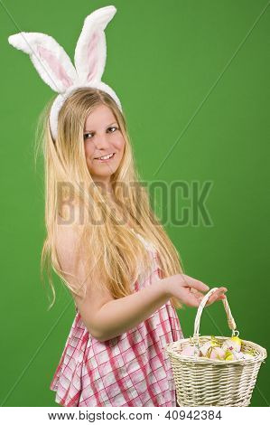 Young Woman With Easter Eggs In Basket