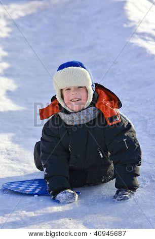 Kid Riding A Frozen Hill