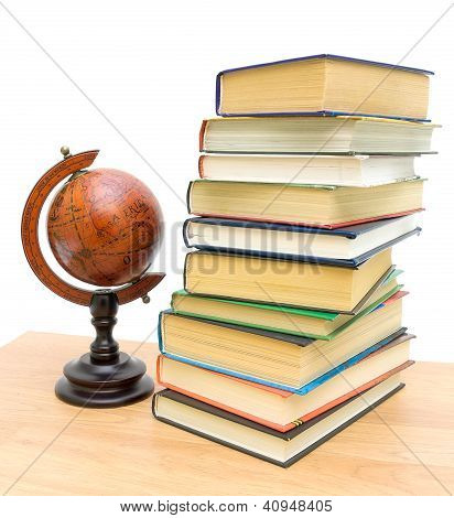 Antique Globe And A Stack Of Different Books