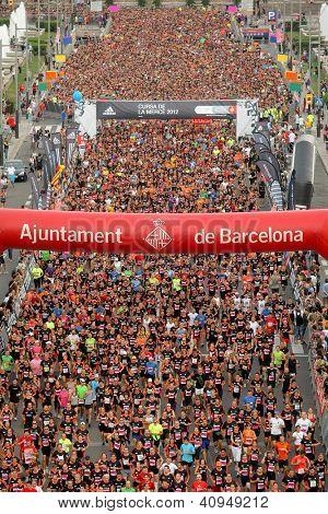 BARCELONA - SEPT, 16: Runners on start of La Cursa de la Merce, a popular race in Montjuich Mountain on September 16, 2012 in Barcelona, Spain