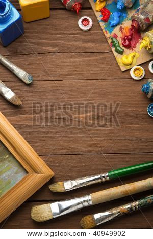 brush and painting  on wood background