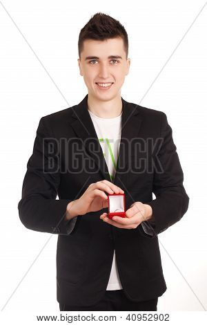 Young man holdin red box with ring