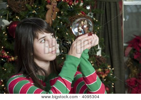 Girl Holding Nativity Ornament