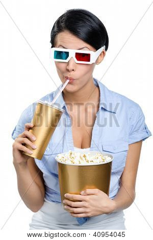Girl in 3D glasses drinking beverage with popcorn and watching film, isolated on white