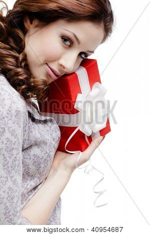 Young woman is satisfied with a gift wrapped in red paper, isolated on white