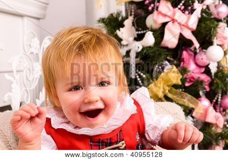 cheerful baby near christmas tree