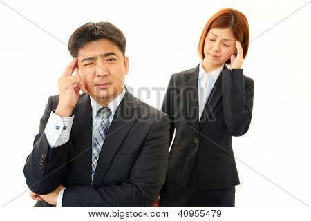 Stressed business man and woman