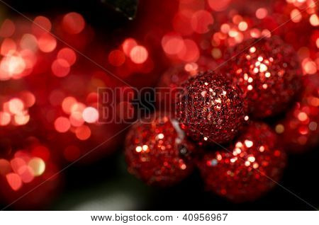 Christmas Red Shining Baubles Against Red Defocused Background