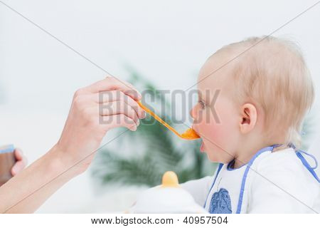 Baby eating in living room