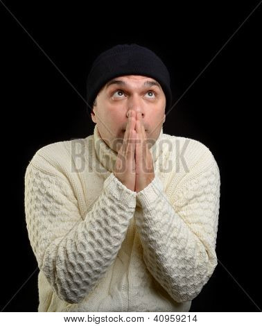Caucasian adult trying to warm up isolated on black background