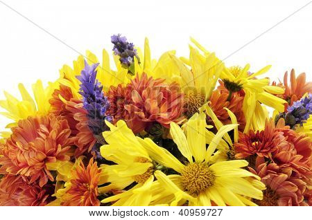 closeup of a flower arrangement with different flowers, such as gerbera daisies and lavender