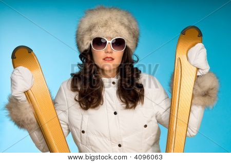 Fashion Model With Golden Skis