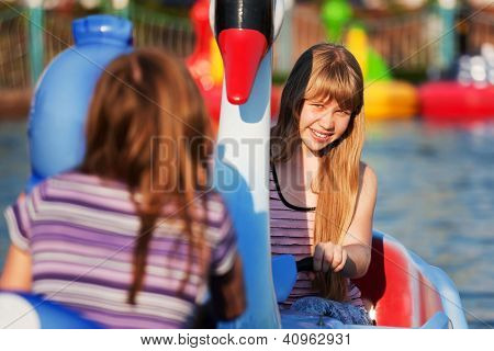Teenage girls having fun in a water park