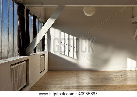 wide open space, beams and wooden floor