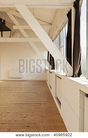 interior wide loft, beams and wooden floor