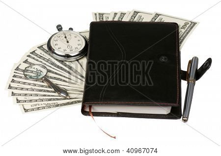 Heap of dollars with stopwatch and notepad isolated on a white background