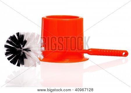 Plastic orange toilet brush isolated on white background