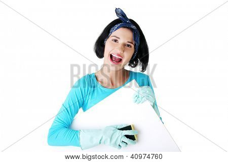 Smiling happy cleaning woman showing blank sign board.